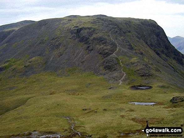 Beck Head and Beckhead Tarn with Kirk Fell beyond from below Westmorland Cairn, Great Gable