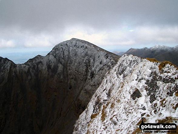 Looking along the second of the 3 summits on Caher towards Carrauntoohill<br>