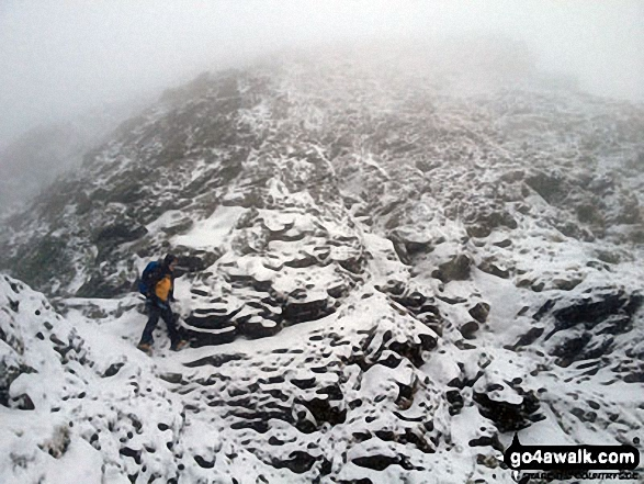My mate Rich just strolling past the 'Bad Step' on Sharp Edge  without really noticing it!