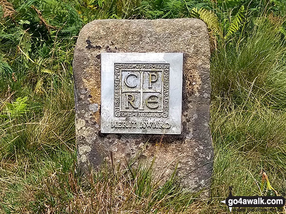 C.P.R.E. (Campaign to Protect Rural England) marker stone on Nether Hey Moor above Hey Bank