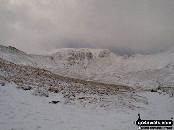 Helvellyn Summit flanked by Striding Edge (left) and Swirral Edge (right) from Hole-in-the-Wall in the snow