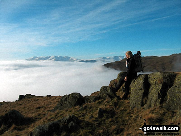 My wife just below High Pike (Scandale) during a temperature inversion on the Fairfield Horseshoe. Walk route map c247 The Fairfield Horseshoe from Ambleside photo