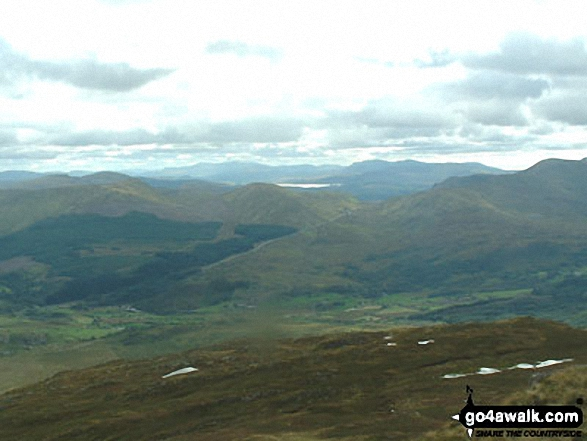 A distant view of Cadair Idris and The Rhinogs from the SE ridge of Carnedd Moel Siabod. Walk route map cw108 Carnedd Moel Siabod from Plas y Brenin, Capel Curig photo