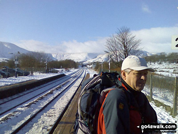 Mike at Edale Station with Lord's Seat, Cowburn Tunnel and Brown Knoll in the background. Walk route map d296 Jacob's Ladder and Kinder Scout from Edale photo