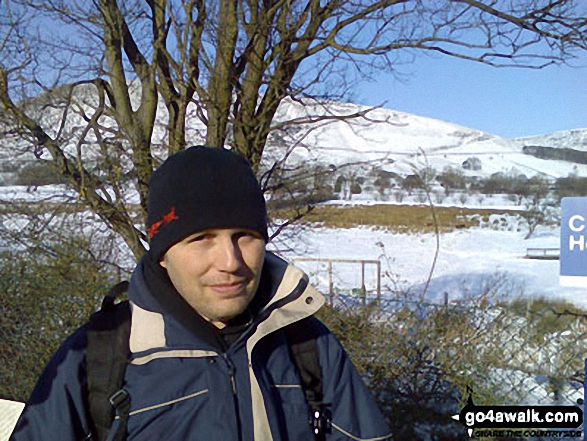 Carl Morris at a snowy Edale Station with Grindslow Knoll (Kinder Scout) in the background. Walk route map d296 Jacob's Ladder and Kinder Scout from Edale photo