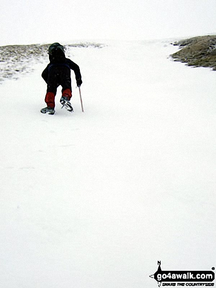 Practising my crampon and ice-axe technique in the snow on Whernside