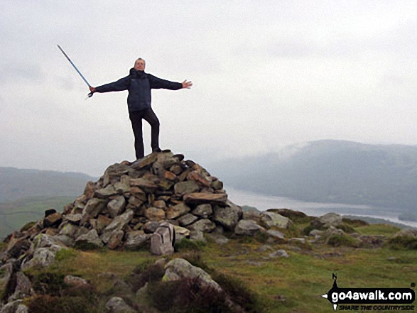 On the summit of Beacon (Blawith Fells) with Coniston Water and Carron Crag in the background