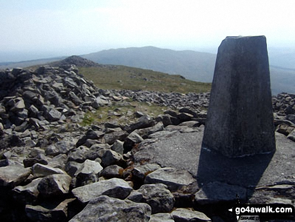 Pen Pumlumon Fawr (Plynlimon) summit trig point with Y Garn (Pumlumon) in the distance