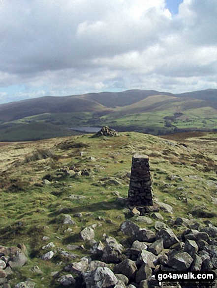 Binsey Trig Point and cairn with The Uldale Fells (Brae Fell, Great Sca Fell and Knott) beyond