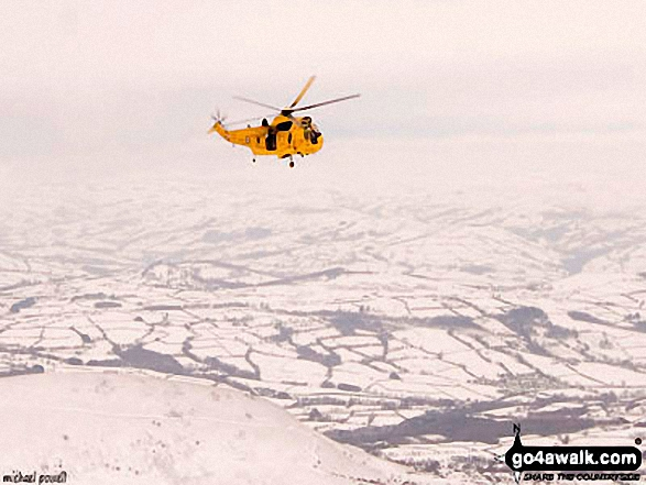 Mountain Rescue helicopter above Pen y Fan in the snow