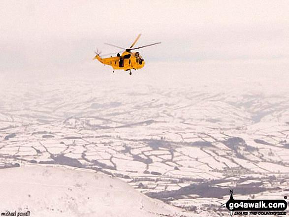 Walk po127 Fan y Big, Cribyn, Pen y Fan and Corn Du from Neuadd Reservoir - Mountain Rescue helicopter above Pen y Fan in the snow
