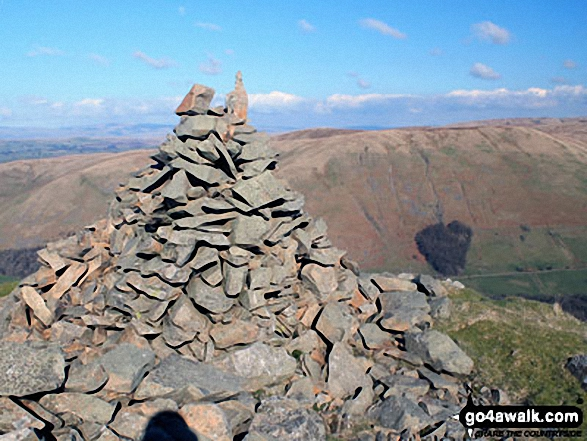 Grayrigg Pike (Grayrigg Forest) summit cairn with Blease Fell in the background