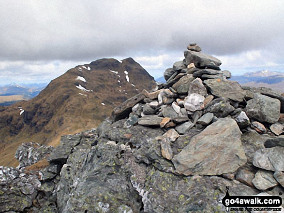 The summit cairn on Beinn Tulaichean with Cruach Ardrain in the background