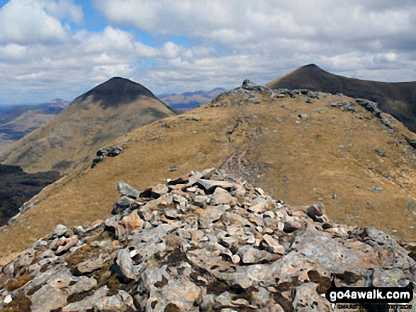 Cruach Ardrain summit from the 1st slighty lower cairn with Ben More (left) and Stob Binnein (right) in the background