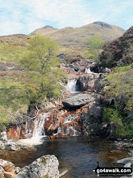 Allt Riobain waterfalls with Sgiath Chuil (left) and Sgiath Chrom on the horizon