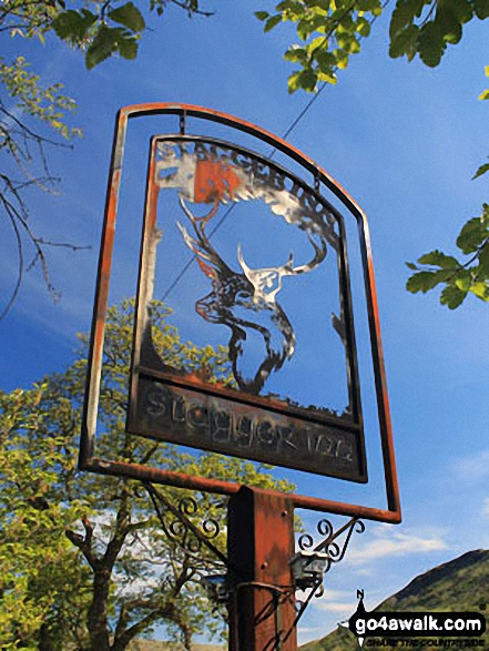 The Stagger Inn sign outside the Drovers Inn in Inverarnan