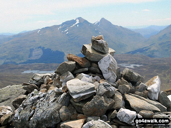 Beinn Challum (South Top) summit cairn with Ben More and Stob Binnein in the distance