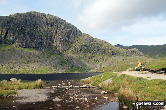 Brett resting at Stickle Tarn with Pavey Ark