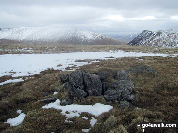 The rocky summit of Sale How (Skiddaw) in the snow with Bowscale Fell (left) and Blencathra or Saddleback with Sharp Edge clearly visible (right) on the horizon