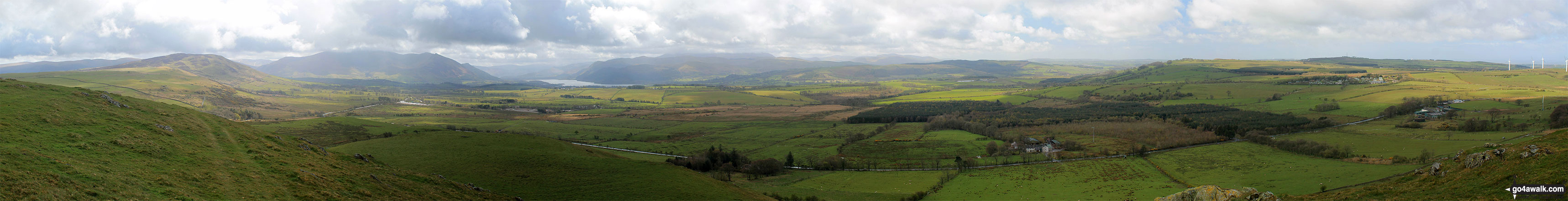 The Northern Fells (Binsey (left), Blencathra or Saddleback and Skiddaw), Bassenthwaite Lake and The North Western Fells (Sale Fell, Broom Fell, Lord's Seat and Barf) from the summit of Caermote Hill