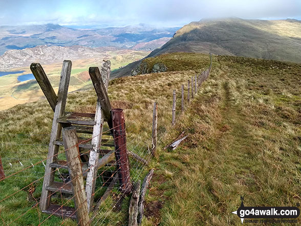 Ladder stile on the summit of Tyrrau Mawr (Craig-las) with Cyfrwy (The Saddle) and Cadair Idris (Penygadair) in the background