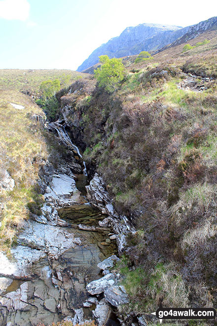 Waterfalls above Muiseal on the lower slopes of Ben Hope with Ben Hope itself towering above in the background