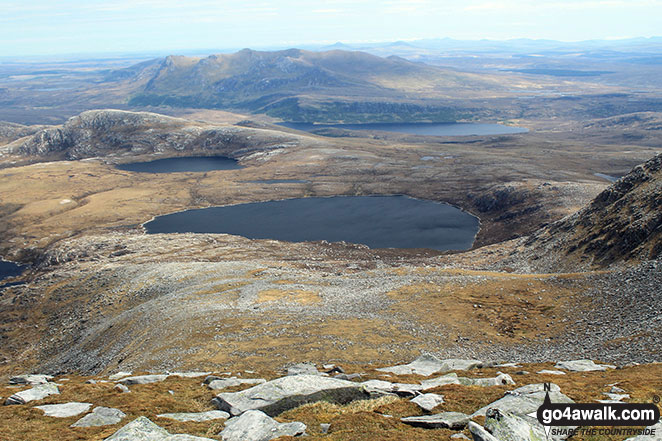 Loch a' Ghobha-Duibh (centre), Dubh-Loch Creige Riabhaich and Meallan Liach (left) with Loch an Dherue and An Caisteal (Ben Loyal) (in the distance) from the summit of Ben Hope
