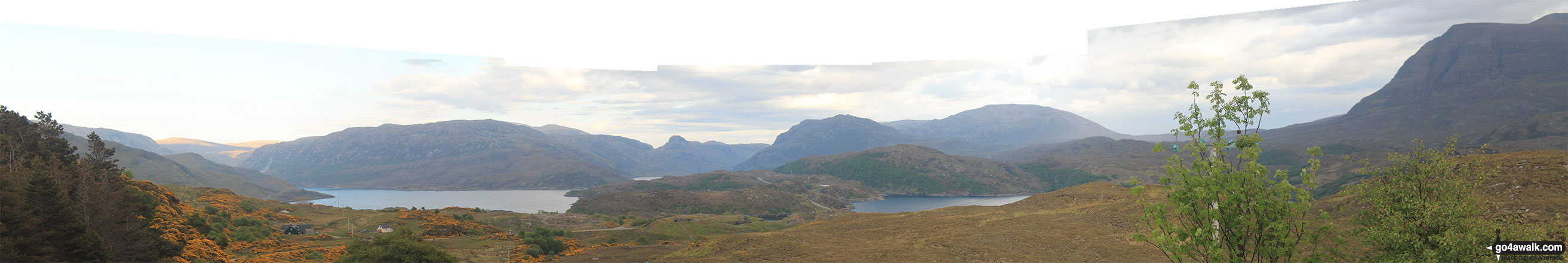 Panoroama featuring Glas Bheinn (Ben More Assynt) and the shoulder of Spidean Coinich (Quinag) from the Assynt viewpoint on the A838 (North Coast NC500 route) at Bealach Strome
