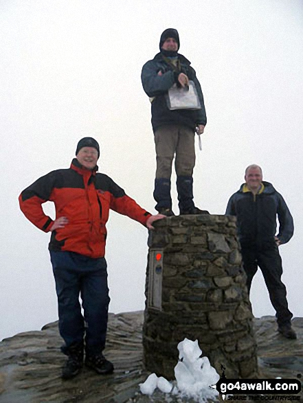Three of my work colleagues at the top of Snowdon. Walk route map gw105 Snowdon via The Watkin Path from Nantgwynant photo