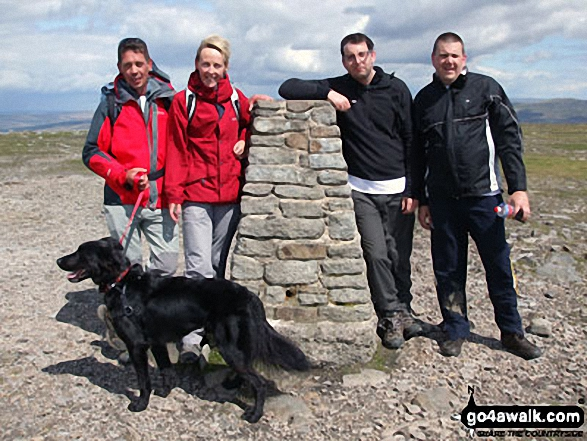 Myself, Paul Baldry, Max the Dog, Jenny Baldry, Tom Evans and Martin Brown on top of Ingleborough. This was taken during our Yorkshire 3 Peaks Challenge for Cash 4 Kids Charity for which we have raised over �1500. We completed all three in 11 Hours, a very tiring but fulfilling day and a day we�ll remember for a long time. P.S Fantastic site, as we used your very detailed map and data for my GPS.