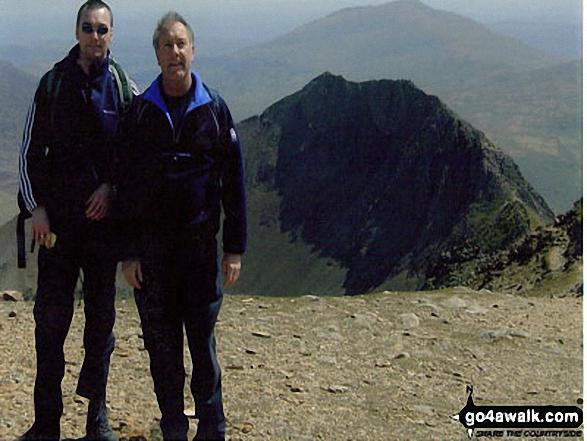 Me and my dad (Dave) on Garnedd Ugain having just climbed across Crib Goch. Walk route map gw100 Mount Snowdon (Yr Wyddfa) from Pen y Pass photo