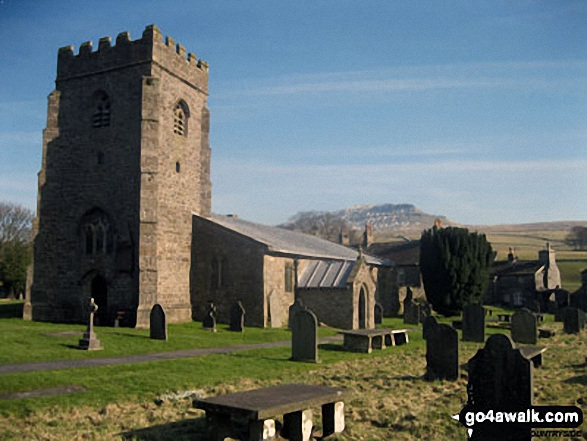 Horton in Ribblesdale church with Pen-y-ghent in the distance. Walk route map ny101 The Yorkshire Three Peaks from Horton in Ribblesdale (New 2013 Route) photo