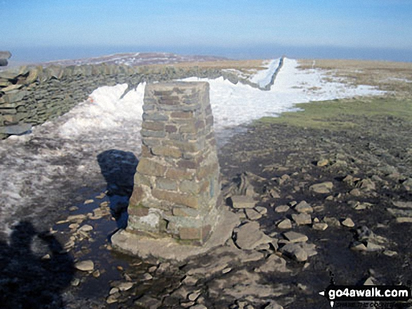 Pen-y-ghent summit trig point with a little bit of snow