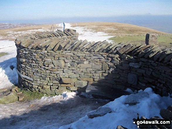 Pen-y-ghent summit wind shelters in a little bit of snow