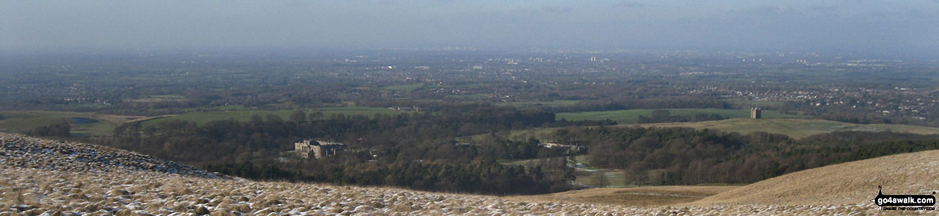 Lyme Hall (left) and The Cage (right) with Manchester and Stockport beyond from the memorial in Lyme Park Country Park just north of Bowstonegate Farm