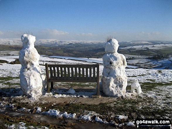 A Snow Man, Snow Woman and their Snow Dog enjoying the fantastic view from Sponds Hill
