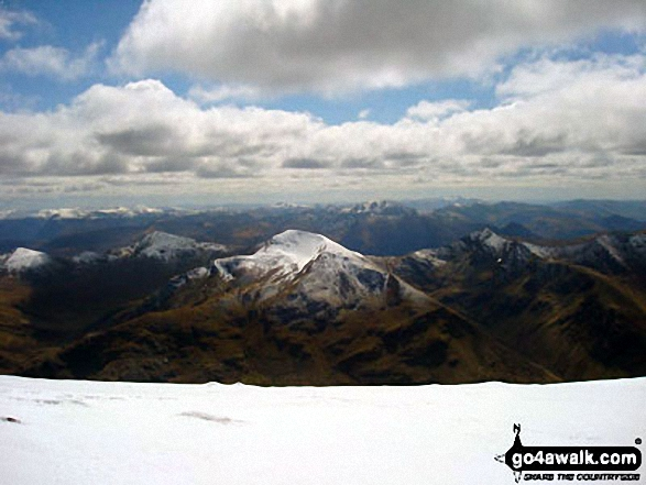 The glorious view south to The Mammores from the top of Ben Nevis - with the snow topped Stob Chiore a' Mhail prominent in the middle of the picture