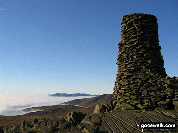 Looking North towards Skiddaw and Blencathra from the summit of Thornthwaite Crag across cloud trapped by a temperature inversion. Walk route map c128 The Hayswater Round from Hartsop photo