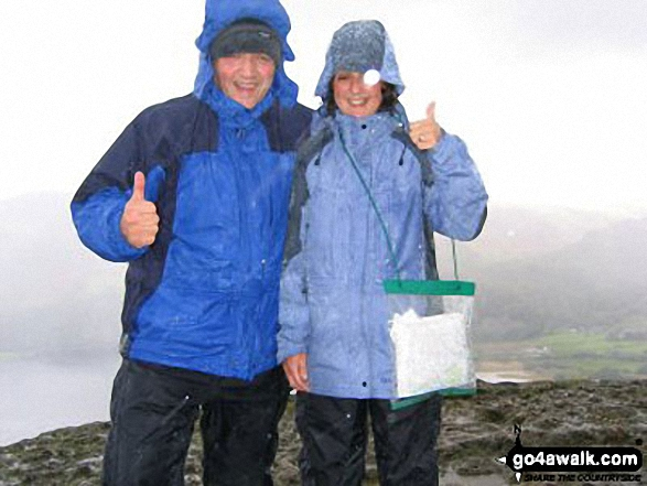 Having fun on Cat Bells (Catbells) in the pouring rain. Walk route map c399 Cat Bells and Derwent Water from Keswick photo