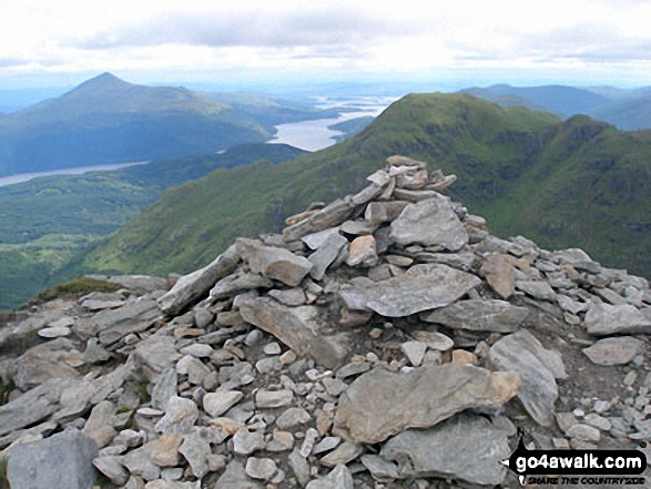Ben Vane summit cairn with Beinn Narnain beyond and Ben Lomond and Ptarmigan in the distance across Loch Lomond