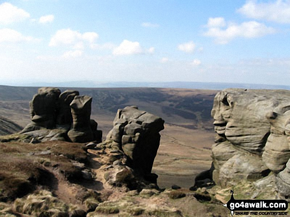 Rock formations on the northern edge of Kinder Scout with Featherbed Moss over Black Ashop Moor in the background.. Walk route map d296 Jacob's Ladder and Kinder Scout from Edale photo