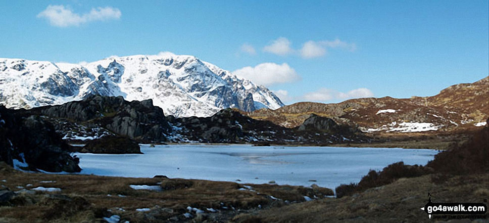 Snow on Scafell Pike and the Scafell Massif from a very frozen Innominate Tarn