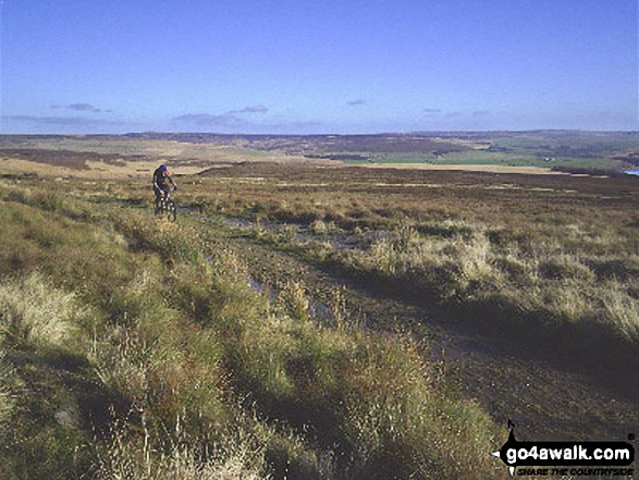 Cyclist on Pennine Bridleway/Burnley Way near Gorple Stones