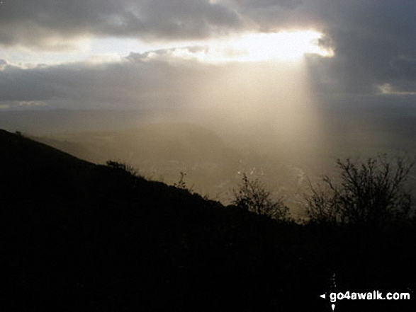 The sun breaks through the clouds from The Offa's Dyke Path<br>above Crag y Fran, Prestatyn