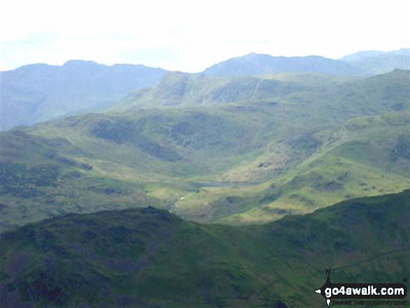 Easedale Tarn and High Raise (Langdale) with Bow Fell (Bowfell), Gunson Knott, Crinkle Crags (Long Top) and Crinkle Crags (South Top) beyond from Fairfield