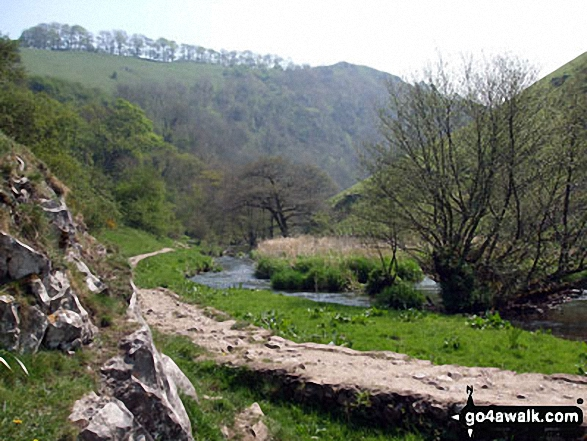 The River Dove in Beresford Dale with Wolfscote Hill above