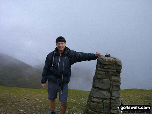 Me at the summit trig point on Helvellyn