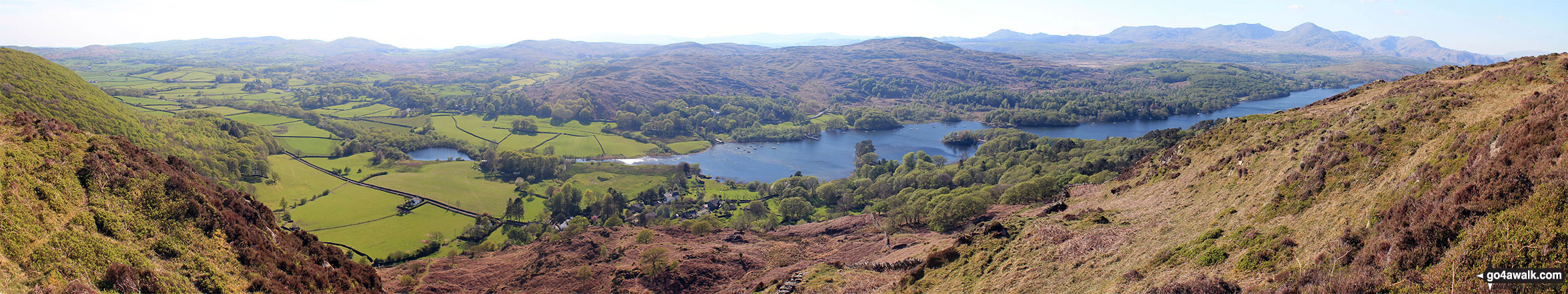 Coniston Water from the summit of Brock Barrow (Top o' Selside) with Beacon (Blawith Fells) prominent (centre) and the Coniston Fells: White Maiden, Walna Scar, Dow Crag, The Old Man of Coniston, Brim Fell, Swirl How and Wetherlam in the background (right)