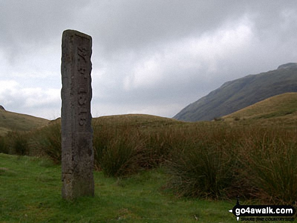 The Three Shire Stone on Wrynose Pass