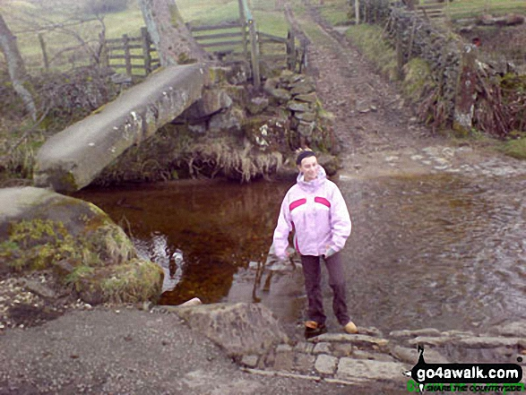 The bronze age bridge across the Colne Water at Wycoller on The Pendle Way.